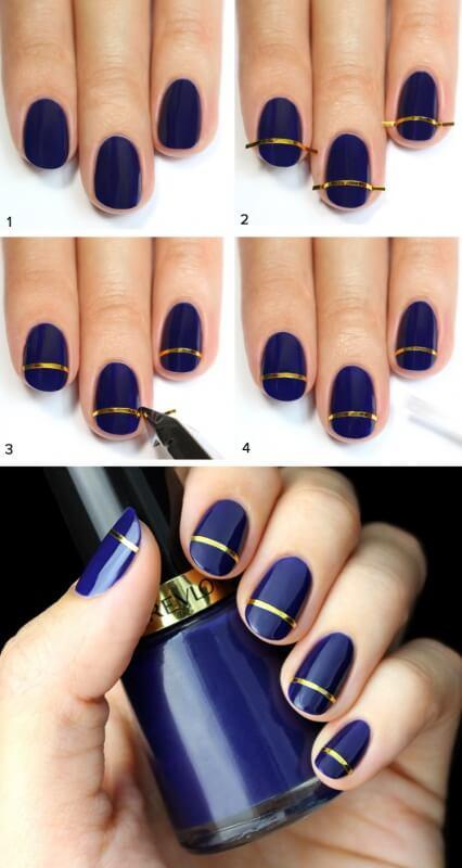 Синий маникюр с золотыми полосками